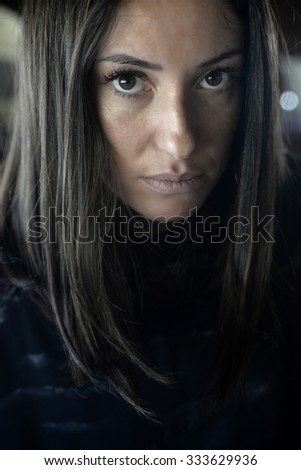Pensive woman-beautiful woman looking at camera with a pensive attitude - stock photo