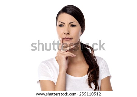 Pensive woman touching her face over white - stock photo