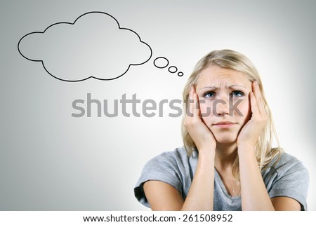 pensive woman with blank thought bubble on gray background