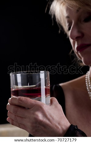 Pensive Woman With Drink, black background