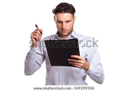 Pensive Young Businessman Holding A Tablet And Pen Isolated On White Background. Business Theme