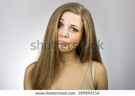 pensive young lady on gray background