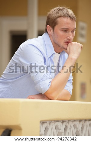 Pensive young man - stock photo