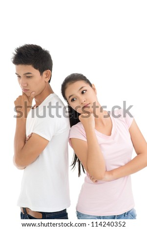 Pensive young people thinking over their relationship - stock photo