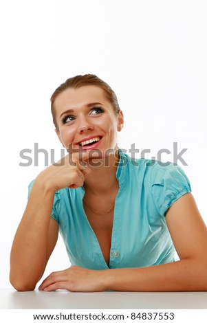 Pensive young woman at  desk isolated - stock photo