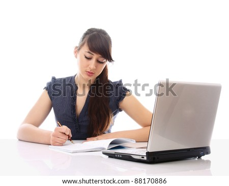 Pensive young woman in front of laptop looking at copyspace, isolated on white
