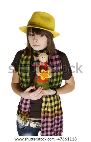 pensive young woman with toys isolated on white