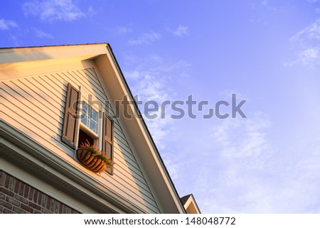 Penthouse window planters with clean sky - stock photo
