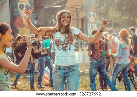 PENZA, RUSSIA - SEPTEMBER 6, 2015: Celebrants dancing during the color Holi Festival