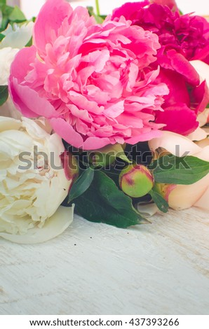 Peony background. Fuchsia, pink and white peonies on wooden table with place for text. Spring flower peony. Happy Mothers Day. Mother's Day greetings card. Mothers Day gift. Valentines Day.Copy space. - stock photo