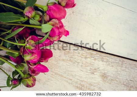 Peony background. Fuchsia, pink peonies on white wooden table with place for text. Spring flowers peonies. Happy Mothers Day. Mother's Day greetings card. Mothers Day gift. Valentines Day. Copy space. - stock photo