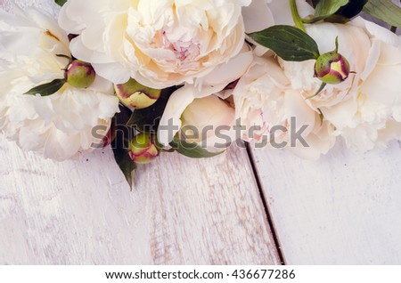 Peony background. White peonies on wooden table with place for text. Spring flowers peonies. Happy Mothers Day. Mother's Day greetings card. Mothers Day gift. Valentines Day. Copy space. Toned image. - stock photo