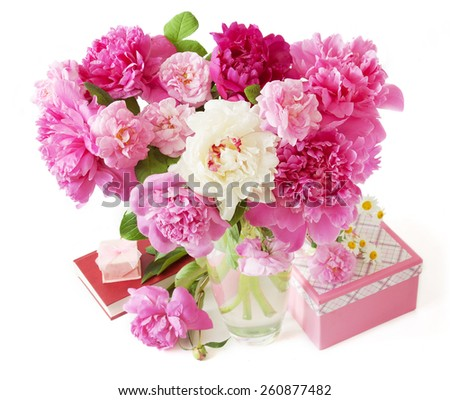 Peony bunch, present box and book isolated on white background. Teacher's Day concept.   - stock photo