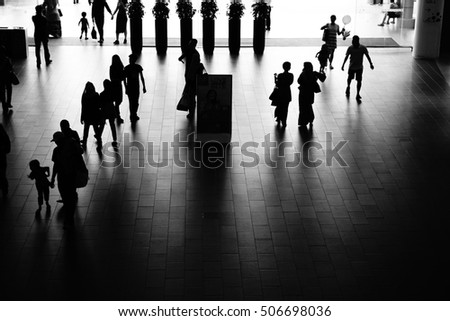 people activity standing and walking in the lobby, black and white