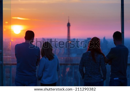 People admiring Paris and Eiffel Tower from Montparnasse Tower a - stock photo
