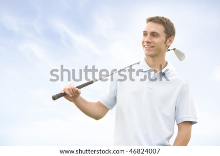 People against blue sky with golf clubs