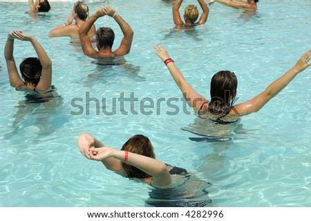 People are doing aerobic in pool - stock photo