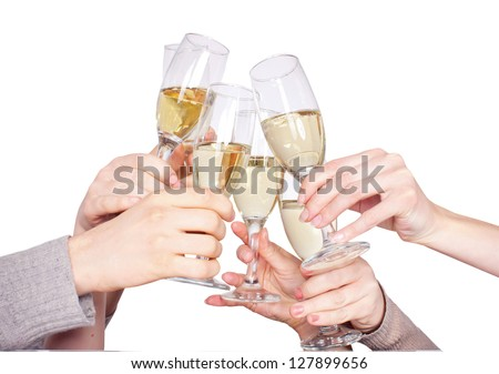 people are holding the glasses of champagne and celebrate - stock photo