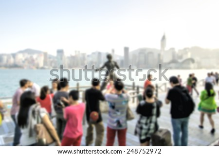 People are photographed on the waterfront of Hong Kong. The Monument To Bruce Lee. Avenue of stars. - stock photo