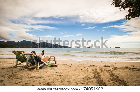 People are relaxing on the beach - stock photo