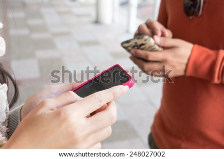 People are using phone to find directions during the tour - stock photo