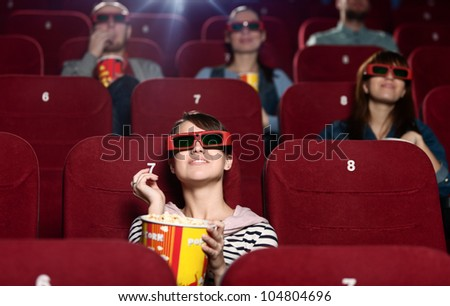 People are watching a movie in 3D - stock photo