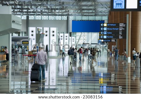 People at the airport. Long-time exposure motion blur. - stock photo