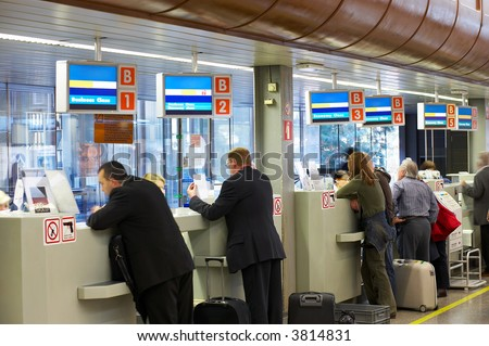 people at the airport's check-in - stock photo