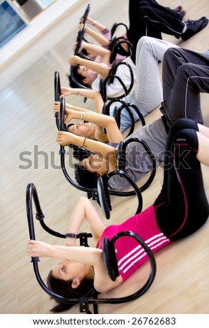 People at the gym doing sit-ups on a machine - stock photo