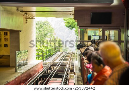 People at the station waiting for the tram. Blurred. Hong Kong, Victoria Peak. - stock photo