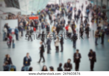 People at trade show, generic background. Intentionally blurred editing post production. - stock photo