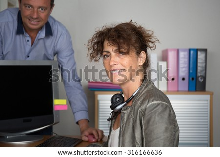 People at work in a bright and modern office building