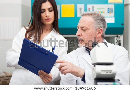 People at work in a scientific laboratory - stock photo