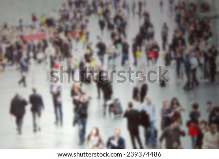 People background, intentionally blurred post production. - stock photo