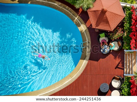 People bathe in the swimming pool of the hotel View from above. - stock photo