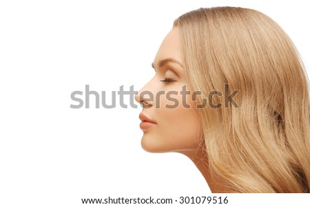 people, beauty and hair care concept - beautiful woman face with long blond hair - stock photo