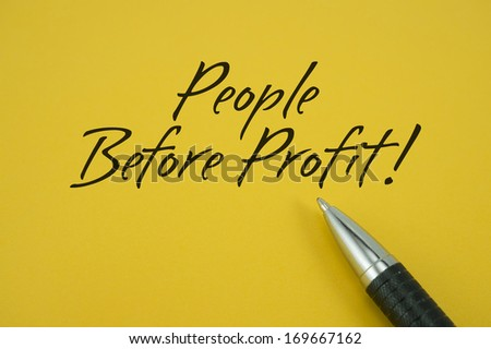 People Before Profit note with pen on yellow background