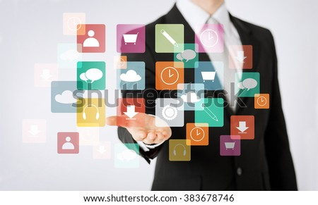 people, business, technology and management concept - close up of man hand showing application menu icons projection