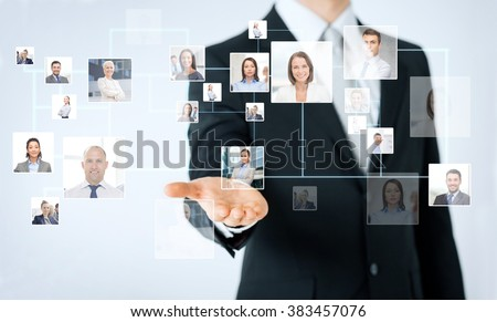 people, business, technology, headhunting and cooperation concept - close up of man hand showing business contacts icons projection - stock photo