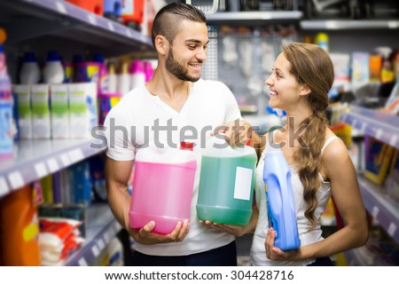 people buying detergents for house in the shopping mall