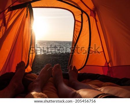 people camping near sea at summer - stock photo