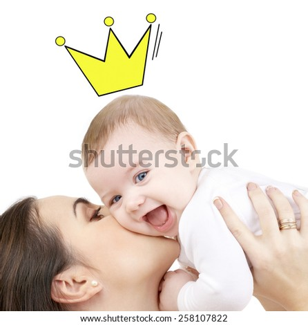 people, childhood, royalty and happiness concept - happy mother kissing and holding baby with crown doodle - stock photo