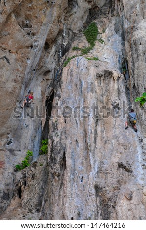 people climbing on the rock route summer (Railay Beach, Krabi province Thailand). - stock photo