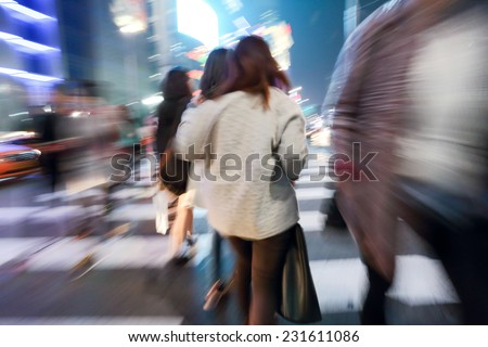 People corssing the street at Dongdaemun,  South Korea (Blurred scene) - stock photo