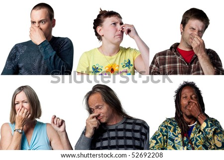 People covering their noses due to a bad smell - stock photo