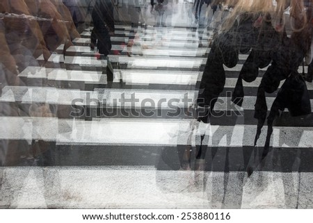 People crossing a road, hurrying, blurred motion - stock photo