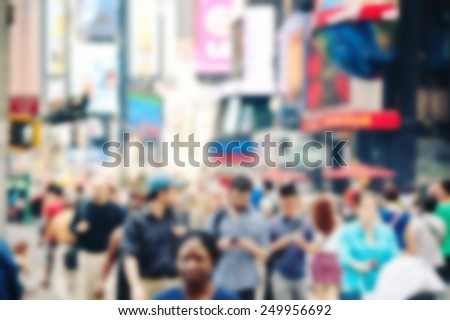 People crossing the street in Times Square, New York. Blurred and filtered image with unrecognizable people. - stock photo