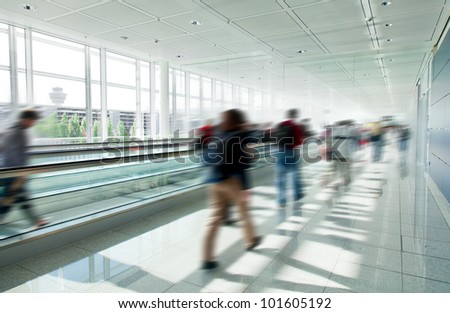 People crowd in rush at airport, blured motion - stock photo