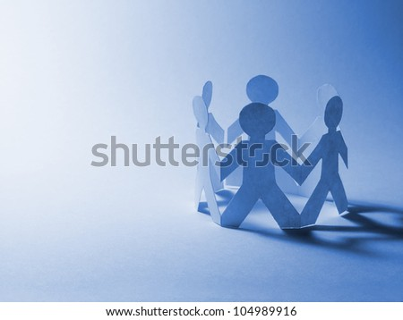 People cut out of paper in blue tone - stock photo