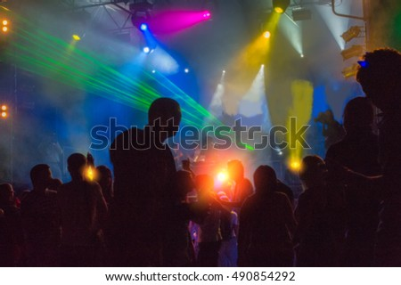 people dancing and having fun at night disco, blurred background